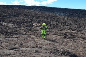 Andrzej Stewart walks across the lava fields.